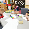 From the left: Junior Rangers Xaven Miller, 4, Zoe Miller, 9 and Xander Miller, 6, all of Centerton, Ark., color tributes to George Washington Carver in an activity room dedicated this week to the memory of his death 75 years ago.<br /> Globe | Laurie Sisk
