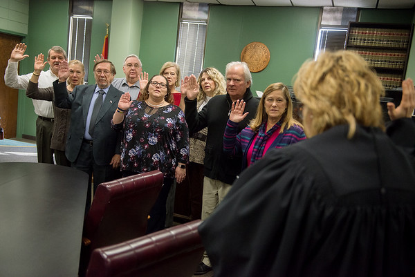 Judge Gayle Crane swears in a group of CASA volunteers at the Jasper County Courthouse in Joplin on Wednesday.<br /> Globe | Roger Nomer