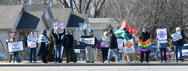 Protestors gather on Maiden Lane before the arrival of Missouri Governor Eric Greitens on Tuesday afternoon across the street from Lozier Corporation.<br /> Globe | Laurie Sisk