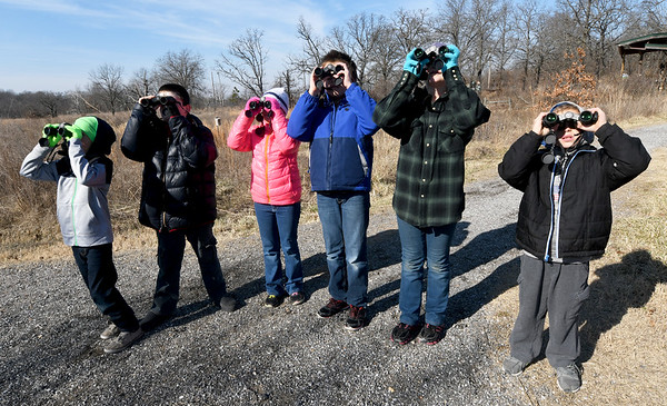 From the left: Alex Thomas, 8, John Thomas, 10, Willow Burchfield, 8, Ian Suzuki, 11, Elly Burchfield, 10 and Trendon Renburg, 8, participate in the Kids' Christmas Bird Count on Saturday at Wildcat Glades.<br /> Globe | Laurie Sisk