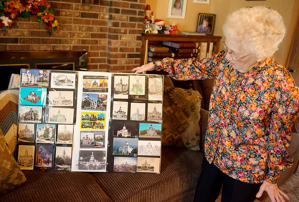 Charlyn Hubbard talks about postcards she has collected of the Jasper County Courthouse in Carthage.<br /> Globe | Roger Nomer