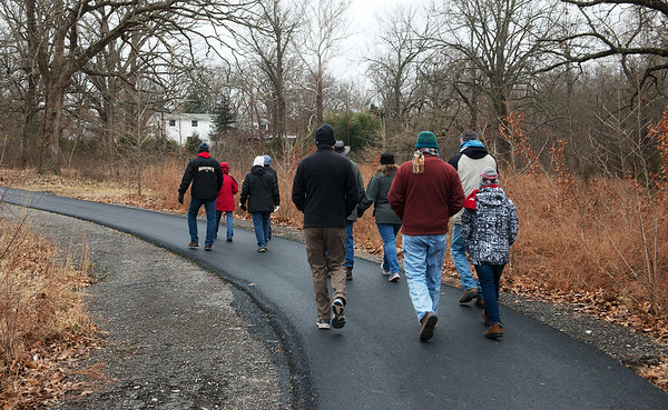 Hikers depart on the First Day Hike at Wildcat Glades on Tuesday.<br /> Globe | Roger Nomer