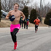 Erik Ghumm, Pratt, Kan., braves the freezing temperatures as he finishes the Chilly 5K at the Joplin Family YMCA on Tuesday.<br /> Globe | Roger Nomer