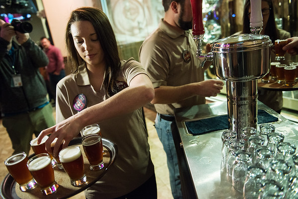 Globe/Roger Nomer<br /> Chelsea Barnard prepares to serve beer samples on Thursday at Downstream Casino.
