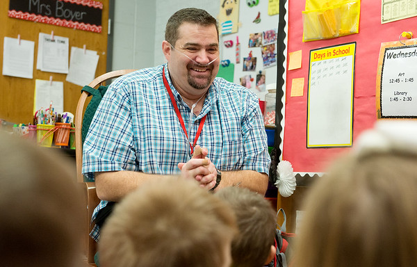 David Meinershagen talks with first graders at Webster Elementary in Webb City as he substitute teaches on Wednesday morning.<br /> Globe | Roger Nomer