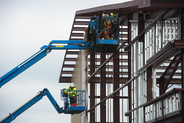 Workers construct the exterior of the new Freeman Fieldhouse on the campus of Crowder College in Neosho on Wednesday.<br /> Globe | Roger Nomer