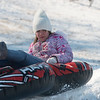 Globe/Roger Nomer<br /> Maddie Martin, 10, hits a jump while sledding at Ozark Christian College on Tuesday.