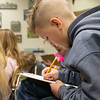 Brady Weston, fourth grade, works on a math problem during class on Thursday at Cecil Floyd. <br /> Globe | Roger Nomer