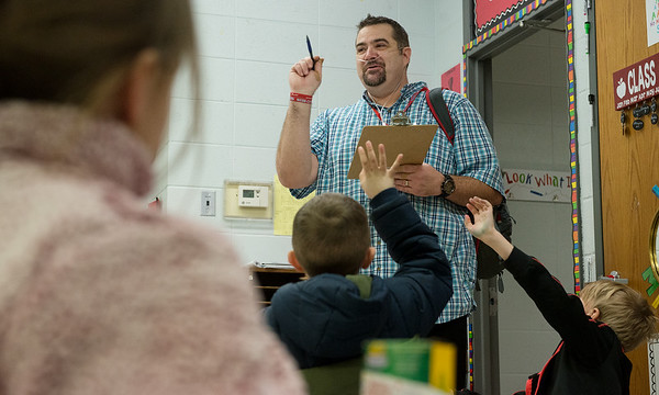 David Meinershagen organizes class for the day as he substitute teaches at Webster Elementary in Webb City on Wednesday.<br /> Globe   Roger Nomer