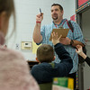 David Meinershagen organizes class for the day as he substitute teaches at Webster Elementary in Webb City on Wednesday.<br /> Globe | Roger Nomer