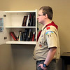 Globe/Rayna Karst<br /> Phillip Miner, Carthage High School senior and member of Boy Scout Troop 24, stocks books in the new lending library yesterday at Freeman Health System's Sports and Rehabilitation location, 2206 E. 32nd St. Miner built the lending libraries as his project to earn the Eagle Scout rank, which is the highest rank in the Boy Scouts of America.