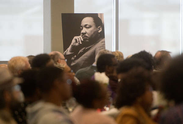 People listen to Lyle Foster give his remarks during Monday's Martin Luther King Jr. breakfast at Missouri Southern.<br /> Globe | Roger Nomer