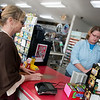Globe/Roger Nomer<br /> Susan Petty, Neosho, buys a Powerball ticket from Jeanna Garrett on Friday at Doc's Stop in Joplin.