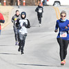 Pictured right, Kathy Ritchhart, of Carthage leads a pack of runners to the finish line during the Joplin Family YMCA's Chilly 5k on Monday morning at the YMCA. Ninety four runners braved frigid temperatures to run the annual New Year's Day race.<br /> Globe | Laurie Sisk