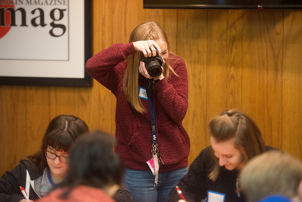 Jacey Starks, Diamond High School sophomore, takes photos of students in a feature writing class during the Joplin Globe's 30th Annual Journalism Workshop Day on Monday.<br /> Globe | Roger Nomer