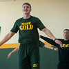 Jacob Holz, a Missouri Southern sophomore from Cassville, smiles as he completes a round of jumping jacks during the PT with the Missouri National Guard event at Billingsly Student Center on Saturday.<br /> Globe | Roger Nomer