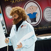 Karen Jones, MSR-marketing for Joplin Metro Credit Union, dresses as Bob Ross on Tuesday at the Joplin Business Expo at Downstream Casino.<br /> Globe | Roger Nomer
