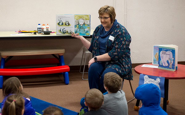 Sherri Luce, children's director at the Carthage Public Library, leads storytime on Wednesday morning in the Library's Community Room. The Library recently reopened their Community Room with a fresh coat of paint and other interior and exterior improvements.<br /> Globe | Roger Nomer