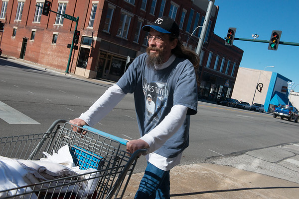 Barry Meyer pushes a cart of donations between the two Souls Harbor locations on Monday.<br /> Globe   Roger Nomer