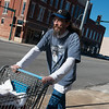 Barry Meyer pushes a cart of donations between the two Souls Harbor locations on Monday.<br /> Globe | Roger Nomer