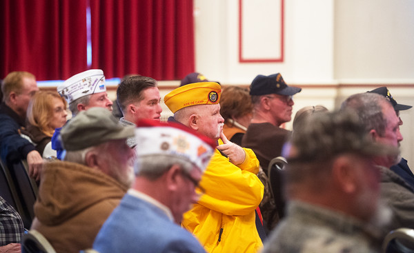 Audience members listen to Kelvin Parks, director of Veterans Health Care System of the Ozarks, during a town hall meeting on Monday in Fayetteville.<br /> Globe | Roger Nomer