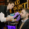 "Jen Tegethoff, of HydraFacial, treats Lance Clevenger to a ""spring cleaning for the skin"" at the Maningas Cosmetic Surgery booth during the 26th Annual Joplin Area Chamber of Commerce Business EXPO at Downstream Casino on Tuesday.<br /> Globe 