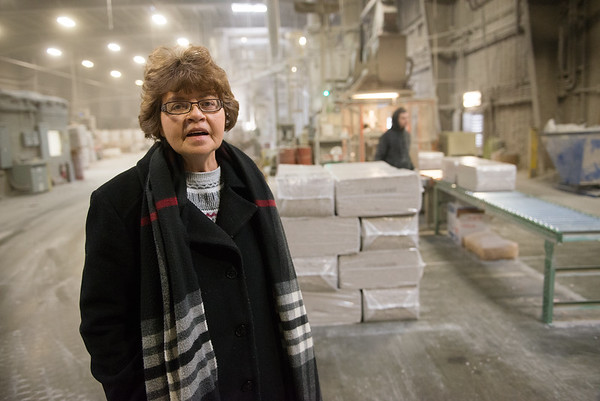 Pat Grubb talks about the production line at Fiberlite on Thursday.<br /> Globe | Roger Nomer