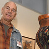 Spiva Artist-in-Residence Richard Zane Smith stands beside one of his high-texture clay pieces on Saturday at the Spiva Center for the Arts.<br /> Globe | Laurie Sisk