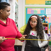 Globe/Roger Nomer<br /> Vickie Gilbert teaches her fourth graders Kaori Gallen and Everett Larue about fractions by using a yardstick on Monday at West Central Elementary.