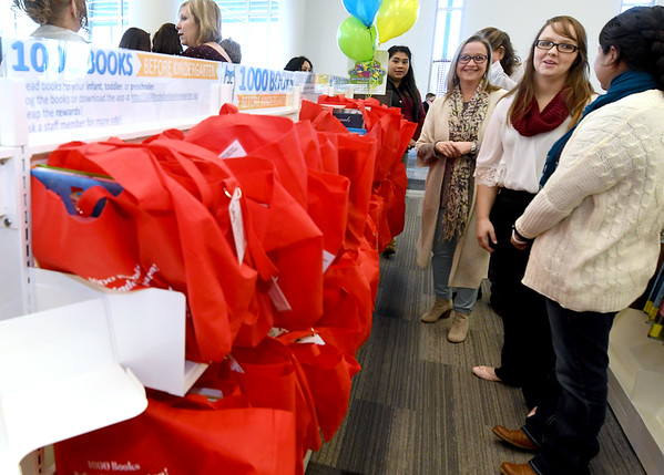Early chidhood educators check out the bags of books ready for check out on Friday morning as the Joplin Public Library kicked off its 1,000 Books Before Kindergarten program.<br /> Globe | Laurie Sisk