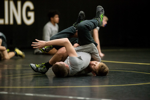 Cayden Auch, freshman, practices wrestling drills with Kolton Sanders, sophomore, on Wednesday at Neosho High.<br /> Globe | Roger Nomer