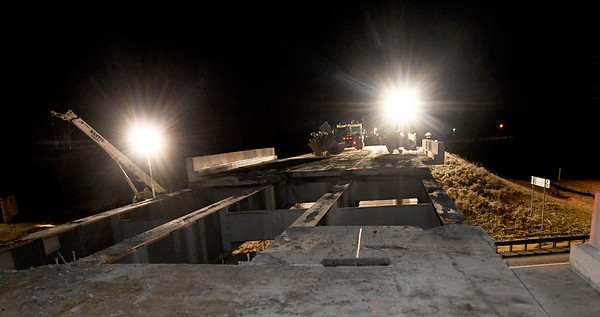 Crews continue dissambling of the Connecticut Street bridge over I-44 on Tuesday night .<br /> Globe | Laurie Sisk