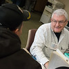 Jim Kastler, Joplin, helps a client with their taxes as he volunteers at Joplin Volunteer Income Tax Assitance on Monday at Great Plains Federal Credit Union. The VITA service offers help preparing federal and state income taxes, and is open from 9 a.m. to 3 p.m. Monday through Friday.<br /> Globe | Roger Nomer