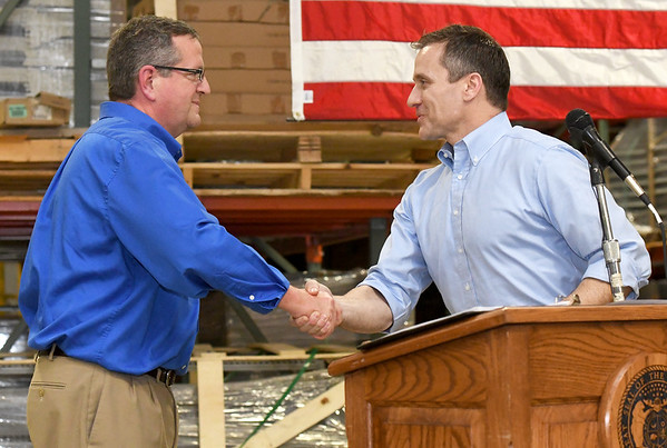 From the left: Lozier Corporation Plant Manager Mark Sockwell greets Missouri Governor Eric Greitens before Greitens' speech on his new tax plan on Tuesday afternoon at Lozier.<br /> Globe | Laurie Sisk