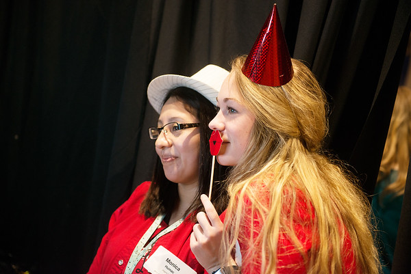 Monica Huinac, left, and Jera Prewitt pose for a photo booth from the Boys and Girls Club of Southwest Missouri on Tuesday at the Joplin Business Expo at Downstream Casino.<br /> Globe | Roger Nomer