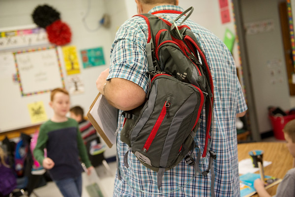 David Meinershagen carries his oxygen tank in a backpack as he substitute teaches at Webster Elementary on Wednesday.<br /> Globe | Roger Nomer