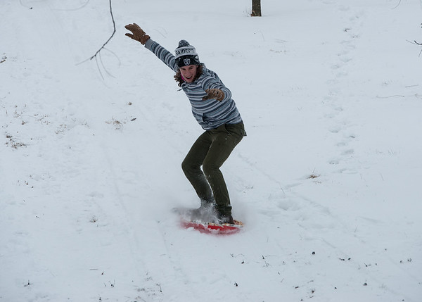 Globe/Roger Nomer<br /> Flint Spencer, an Ozark Christian College freshman from Lyndon, Kan., surfs down a hill at OCC on Monday.