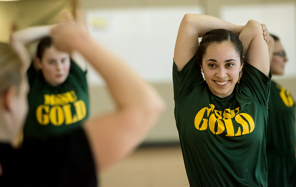 Donna Avila, a Missouri Southern sophomore from Seneca, stretches during the PT with the Missouri National Guard event at Billingsly Student Center on Saturday morning. The Missouri National Guard hosted the workout to encourage fitness in the community and demonstrate exercises for daily training. <br /> Globe | Roger Nomer