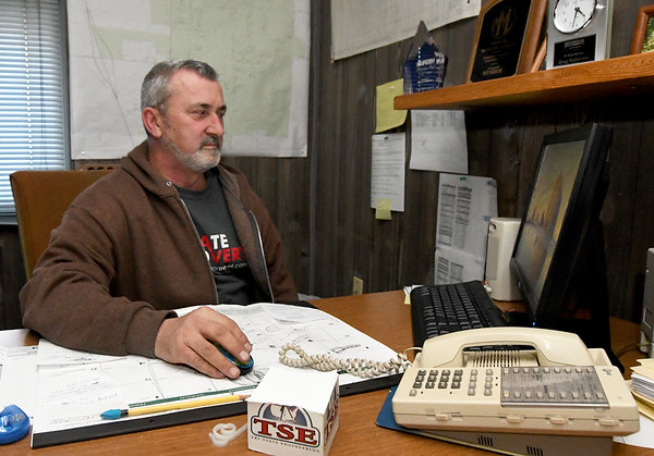 Goodman Mayor Greg Richmond works at his desk at Goodman City Hall on Friday. Richmond, like other Goodman residents, has water quality concerns about a proposed chicken plant outside the city limits.<br /> Globe   Laurie Sisk