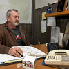 Goodman Mayor Greg Richmond works at his desk at Goodman City Hall on Friday. Richmond, like other Goodman residents, has water quality concerns about a proposed chicken plant outside the city limits.<br /> Globe | Laurie Sisk