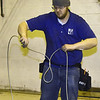 Michael Smith,  of A to Z Theatrical, unwinds galvanized aircraft cable for installation of a new fly system at Joplin Little Theatre on Friday. The work is part of a modernization of the theatre and allows more options for the technical side of productions at the theater.<br /> Globe | Laurie Sisk