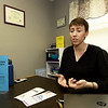 Ali Smith, prevention education specialist at Safehouse Crisis Center, talks about the inportance of human trafficking and stalker awareness in her office on Wednesday in Pittsburg. January is Human Trafficking and Stalking Awareness Month.<br /> Globe   Laurie Sisk