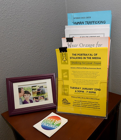 Informational leaflets sit on a table at Safehouse Crisis Center on Wednesday in Pittsburg. January is Human Trafficking and Stalking Awareness Month.<br /> Globe | Laurie Sisk