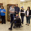 Joplin Police Chief Matt Stewart, left, presents a check for $1,610 to Miracle League of Joplin board member Margie Black on Friday afternoon at the Donald Clark Justice Center. Joining the two are fellow board members and Miracle League athletes. The JPD raised the money from fines during their No Shave November fundraiser.<br /> Globe | Laurie Sisk