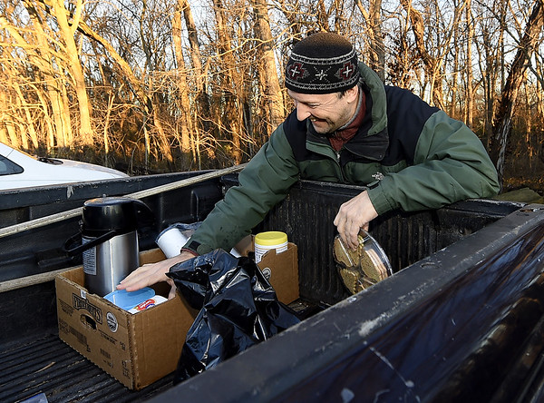 Dan Diehl, of Carthage, organizes hot coffee and cookies for volunteers clearing brush on a half-mile section of the Ruby Jack Trail in Oronogo on Saturday morning.<br /> Globe | Laurie Sisk