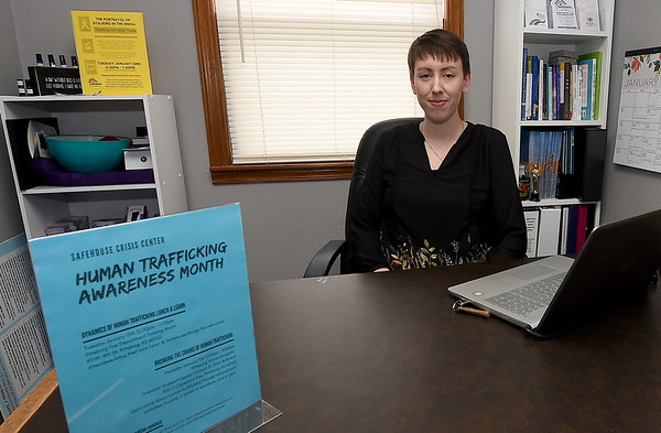 Ali Smith, prevention education specialist at Safehouse Crisis Center, sits in her office on Wednesday in Pittsburg. January is Human Trafficking and Stalking Awareness Month.<br /> Globe | Laurie Sisk
