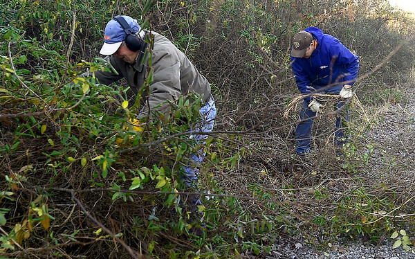 From the left: James Manning and Bob Herbst clear brush on a half-mile section of the Ruby Jack Trail in Oronogo on Saturday morning.<br /> Globe | Laurie Sisk