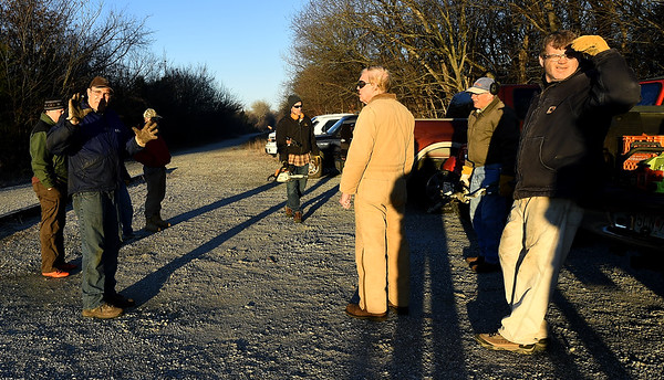 Joplin Trails Coalition volunteers map out their strategy for clearing brush on a half-mile section of the Ruby Jack Trail in Oronogo on Saturday morning.<br /> Globe | Laurie Sisk
