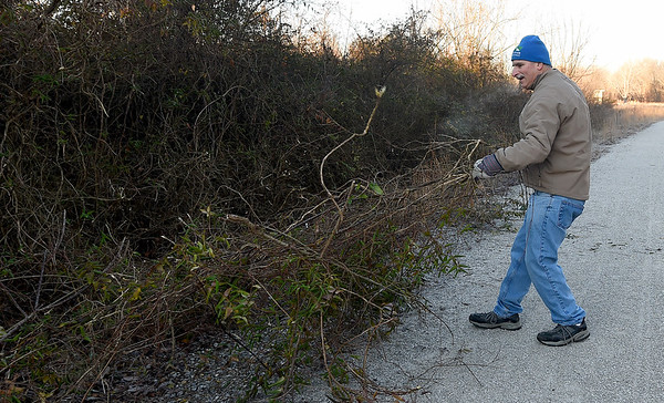 Paul Teverow joins other volunteers from the Joplin Trails Coalition as they clear brush on a half-mile section of the Ruby Jack Trail in Oronogo on Saturday morning.<br /> Globe | Laurie Sisk