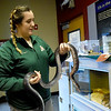 Kensi Tillman, public service assistant for the Missouri Department of Conservation, handles a female black rat snake at the Shoal Creek Conservation Education Center on Friday. Although renovations are taking place at the center, educational programs and information are still available at the center. <br /> Globe | Laurie Sisk